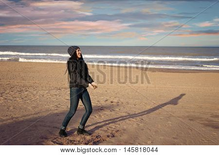teenager playing in winter in a beach of Mar del Plata Argentina