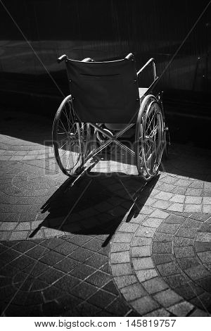 back of wheelchair with a shadow,sick helper concept ,do not abandon a sick people