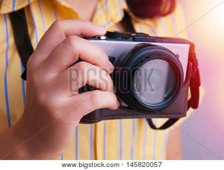 Girl holding camera and taking photo. asia