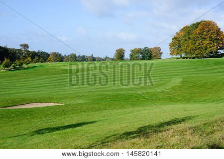 Beautiful sunny autumn day on a golf course