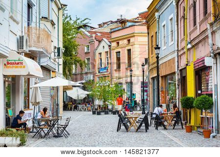 Plovdiv, Bulgaria - September 3, 2016: City center street with houses, cafe and people