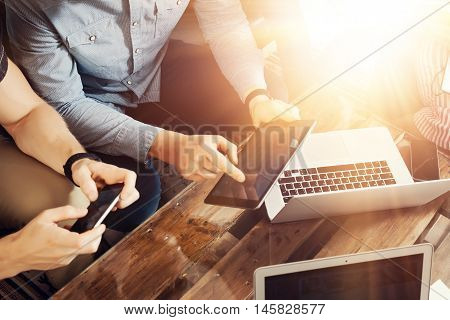 Group Young Coworkers Making Great Business Decisions.Creative Team Discussion Corporate Work Concept Modern Studio Loft.New Startup Marketing Idea Presentation.Mans Touching Screen Tablet Smartphone