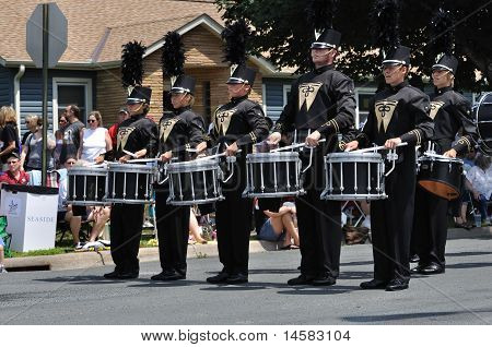 Waconia High School Marching Band Drummers Performing In A Parade
