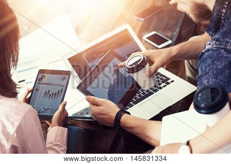 Young Businessman Team Analyze Finance Online Diagram Report Electronic Gadgets.Coworkers Startup Digital Project.Creative People Making Great Work Decisions.Tablet Hands Laptop Table.Closeup Flares