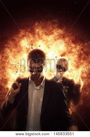 Couple with guns on exploding background