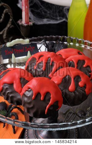 Zephyr in chocolate glaze with a bloody streaks the table on Halloween