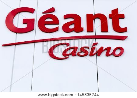 Cholet, France - June 28, 2016: Geant Casino logo on a facade. Geant Casino is a hypermarket chain based in Saint Etienne, France