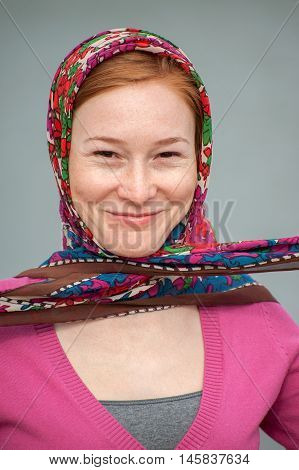 Red-haired woman with a knotted handkerchief on his head