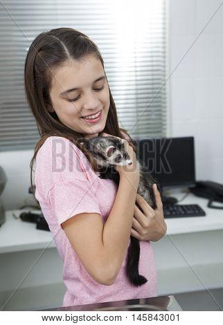 Girl Holding Weasel In Veterinary