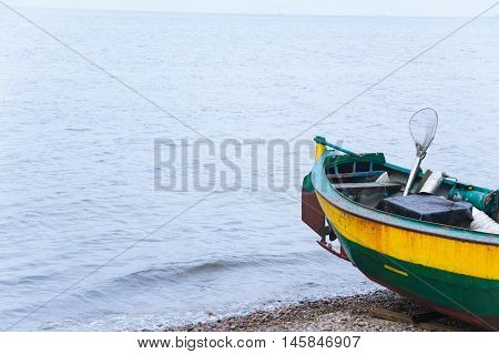 Old wooden fishing boat on the shore of Baltic sea