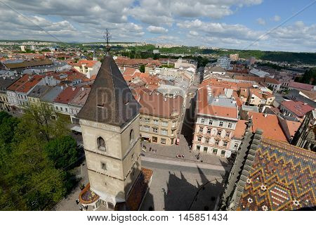 Top view of Kosice (Slovakia Eastern Europe) from Saint Elisabeth Cathedral tower. Old town tower and multicolored tile roof of cathedral in foreground.