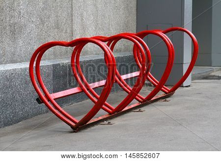 Urban bike rental station in the form of heart