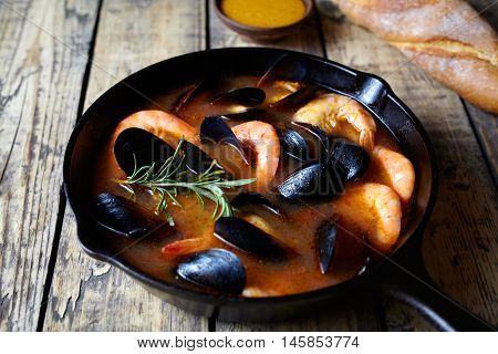 Seafood soup bouillabaisse. Mussels and shrimp in tomato sauce. The traditional dish of Marseilles. He served in France, Italian, Spain. Rustic style.