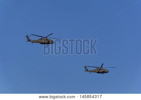 Military helicopters UH-60 Black Hawk against the blue sky