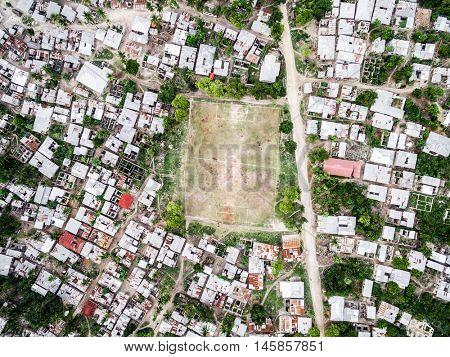 poor fishing village on Zanzibar island with football field, top view, aerial photo