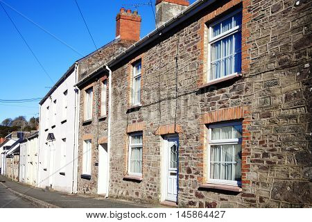 Old fashioned terraced town houses in Laugharne, Carmarthenshire, Wales, UK