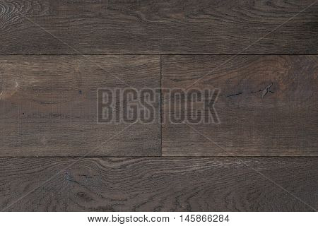 Texture dark brown parquet as abstract texture background, top view. Material wood, oak, maple.