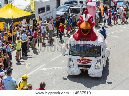 Col du Glandon France - July 23 2015: Le Gaulois vehicle during the passing of the Publicity Caravan on Col du Glandon in Alps during the stage 18 of Le Tour de France 2015. Le Gaulois is an important French producer of poultry meat products