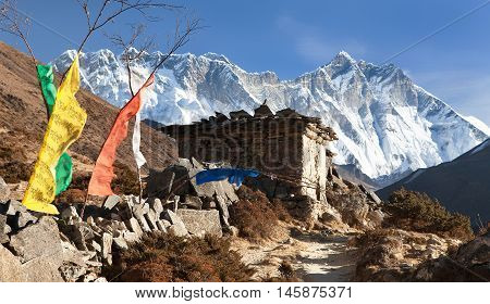 buddhist prayer walls or prayer stupas in nepal on the way to everest base camp - Lhotse Nuptse and top of Mount Everest