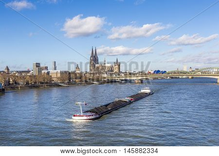 Cologne Skyline With Dome And Bridge And Ship On River Rhine