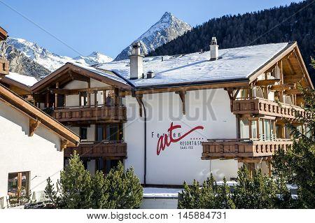 SWITZERLAND, SAAS-FEE, DECEMBER, 26, 2015 - Modern wooden Ferienart Resort & Spa hotel  on a background mountains in the charming Swiss resort of Saas-Fee, Switzerland