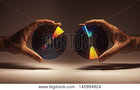 Compact Disks In Hands
