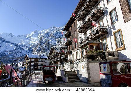 SWITZERLAND, SAAS-FEE, DECEMBER, 26, 2015 - Sunstar Swiss hotel with parked beside electric car in the charming Swiss resort of Saas-Fee, Switzerland