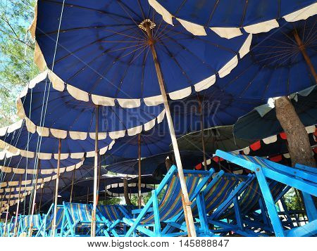 Colorful umbrellas and beach chairs for tourism relax in vocation at Cha-Am beach Thailand