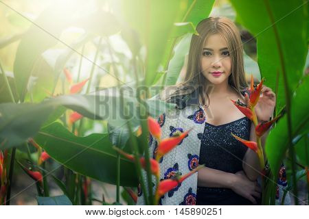 Portrait Of A Beautiful Fashion Girl Wear Traditional In Tree