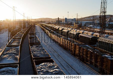 Freight trains with coal in the rays of the sun in Murmansk.