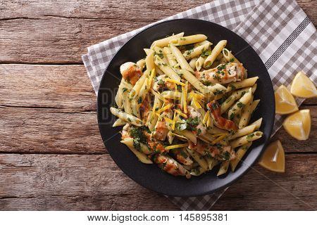 Penne Pasta With Pesto, Chicken Breast And Lemon Closeup. Horizontal Top View