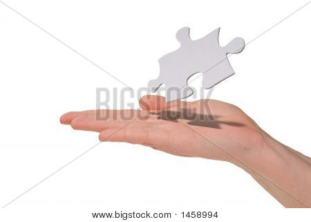 Woman Holding An Puzzle Piece