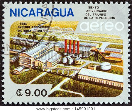 NICARAGUA - CIRCA 1985: A stamp printed in Nicaragua issued for the 6th anniversary of Revolution shows Victoria de Julio Sugar Factory, circa 1985.