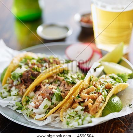 three types of mexican street tacos with barbacoa, carnitas and Chicharr�³n