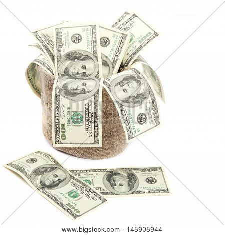 Hundred dollar bills in a canvas sack isolated on a white background.