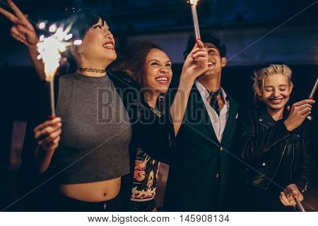 Group Of Friends Having Night Party With Sparklers