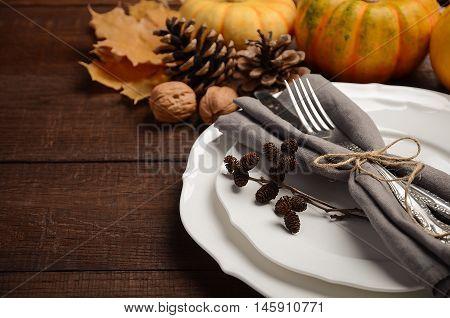 Autumn table setting, selective focus, copy space