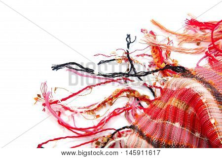 Red scarf with tassels isolated on white background.