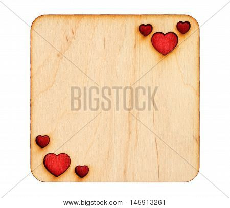Wooden greeting card with scorched hearts with red paper inside isolated on white background