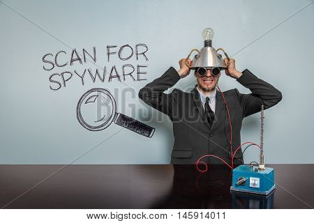 Scan For Spyware text with vintage businessman and machine at office