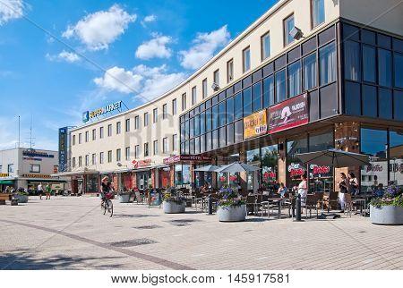 IMATRA, FINLAND - JULY 2, 2016: People in bistro near Center Hotel Imatra on Koskenparras