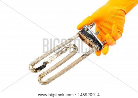 Damaged heating element of the washing machine in hand with rubber gloves isolated on white background.