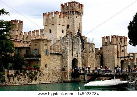 Sirmione Italy - June 1 2006: 13th century feudal Scaligers' Castle (Rocco Scaligeri) built over the waters of Lake Garda