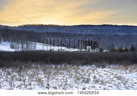 Farm in Winter with View of Mountains
