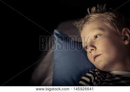 Sleepless Little Boy Laying On Pillow