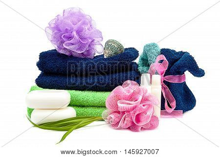 Colored towels washcloths shampoo and soap isolated on white background. Body care products.