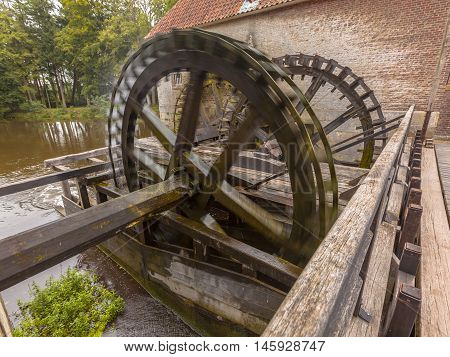 Cogwheels At A Watermill