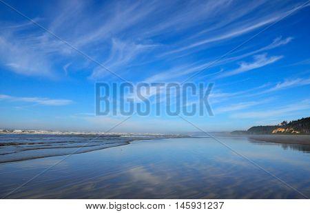 Pacific coast ocean waves and shoreline. Scenic destination of natural beach coast. Pacific Northwest vacation destination.