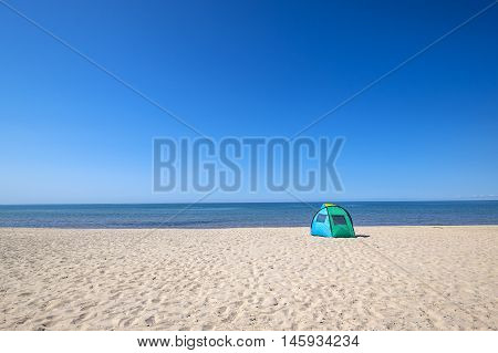 Colorful Solar Shade or Tent on a White Sandy Beach