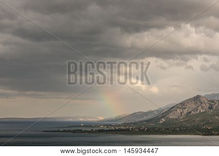 Magic landscape of rainbow above the sea